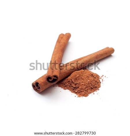 Cinnamon sticks and powder on white background - stock photo