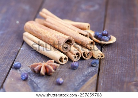 Cinnamon sticks and spices on the wooden vintage table