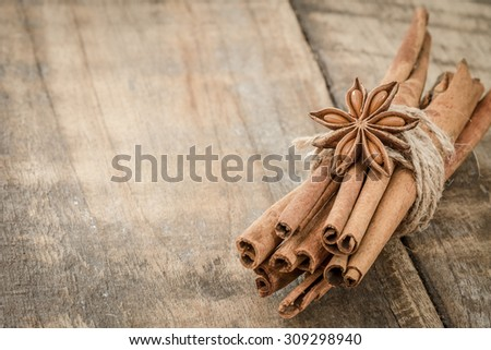 Cinnamon sticks and Star anise on wooden table - stock photo