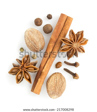 cinnamon sticks, anise star and nutmeg on white background - stock photo