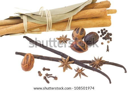 Cinnamon sticks, bay leafs, nutmeg, vanilla sticks, anise, cloves, isolated over white background - stock photo