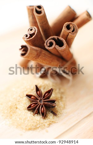 Cinnamon sticks,  brown sugar  and anise stars - stock photo