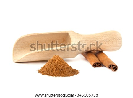 Cinnamon sticks, chalking cinnamon and spoon for spices