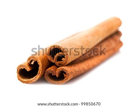 Cinnamon sticks close up isolated on white - stock photo
