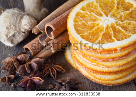 cinnamon sticks, cloves, anise stars, ginger and slices of dried citrus - stock photo