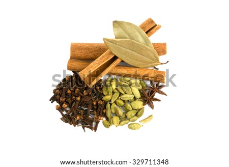Cinnamon sticks. Cloves. Cardamon. Anise stars - stock photo