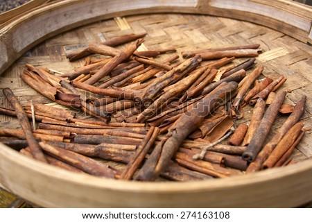 Cinnamon sticks in a basket close up - stock photo
