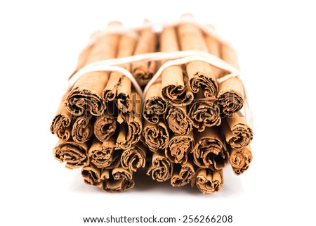 Cinnamon sticks isolated on white - stock photo