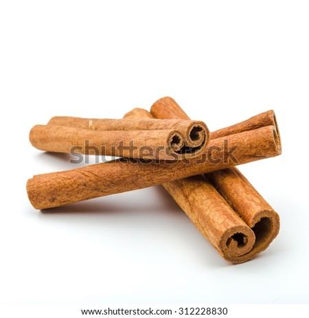 Cinnamon sticks  isolated on white background. - stock photo