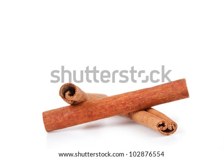 Cinnamon sticks laid out together against a white background