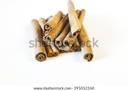 Cinnamon sticks on a white background. Selective focus.