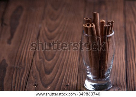Cinnamon sticks on brown wooden background