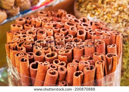 Cinnamon sticks on the Deira market of Dubai, UAE - stock photo