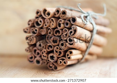 Cinnamon sticks on vintage paper background. Macro, extremely soft focus