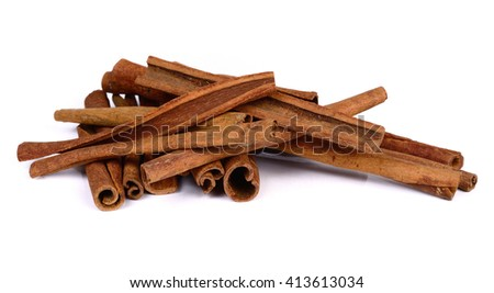 Cinnamon sticks on white background. - stock photo