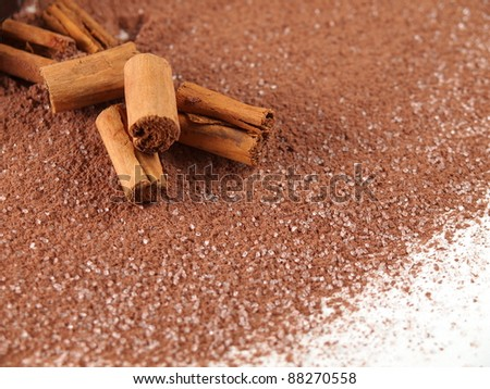 cinnamon sticks over cocoa powder