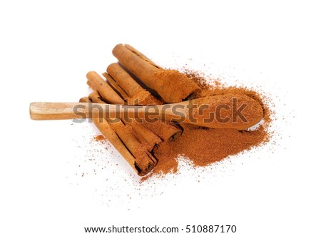 Cinnamon sticks,powder and wooden spoon isolated on white background