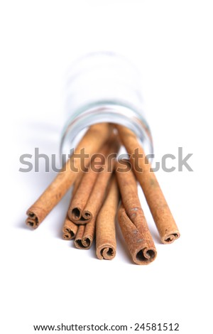 Cinnamon sticks spilled out of a jar