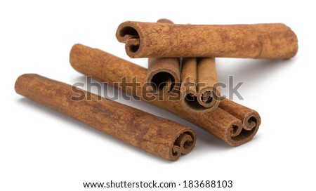 cinnamon sticks stacked on white background
