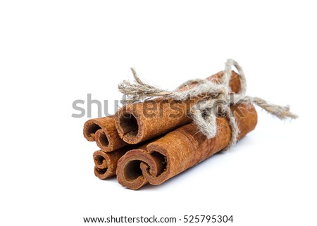 Cinnamon sticks tied with a rope isolated on white background.