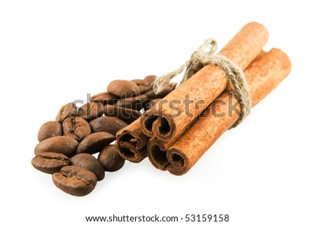Cinnamon sticks to the right on coffee beans