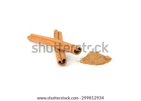 Cinnamon sticks with cinnamon powder isolated on white background - stock photo