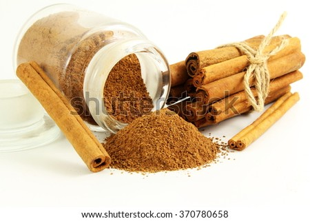 cinnamon sticks with powder in bottle  isolated on white background - stock photo