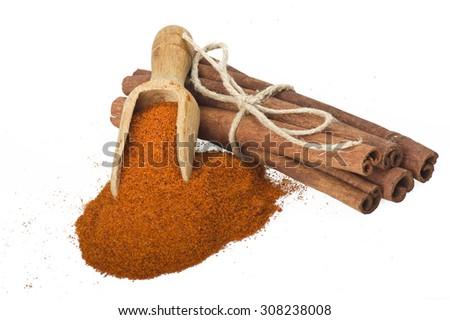 cinnamon sticks with powder on the white background - stock photo