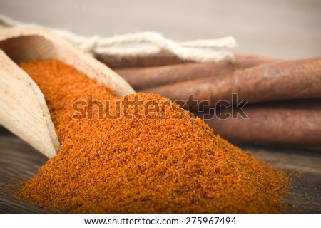 cinnamon sticks with powder on the wood table - stock photo