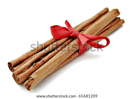 Cinnamon sticks with red ribbon