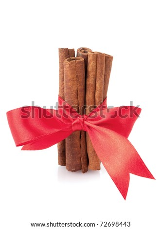 cinnamon sticks with ribbon isolated on white background