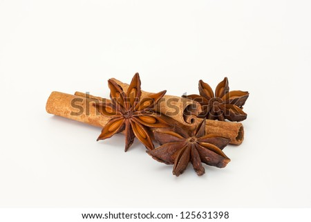 Cinnamon sticks with star anise on a white background