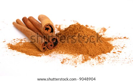 Cinnamon - three sticks and powder - stock photo