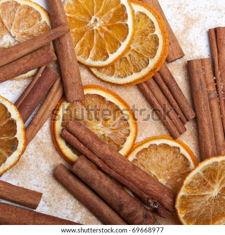 Cinnamon with brown sugar and slices of dried Orange