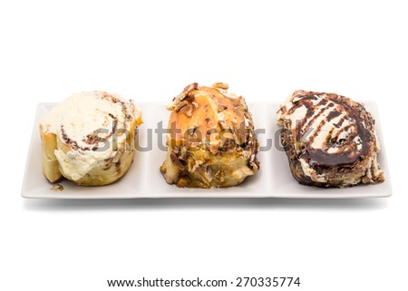 Cinnemon rolls with luxury topping on white background - stock photo
