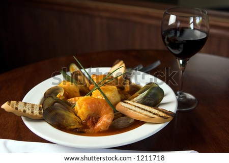 Cioppino, an Italian dish made of fresh seafood including prawns, scallops,clams,mussels and salmon - stock photo