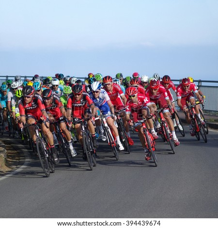 Cipressa, Italy - March 19, 2016: Group of cyclists ride uphill during international cycling race Milan Sanremo. With a distance of 298 km it is the longest professional one-day race in modern cycling - stock photo