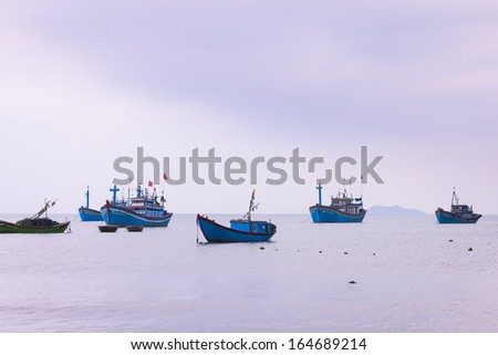 CIRCA APRIL 2010 - QUY NHON, VIETNAM - Fishing boats moored off the shore, on 24 April 2010, at Quy Nhon, Vietnam.