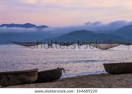 CIRCA APRIL 2010 - QUY NHON, VIETNAM - Fishing nets standing at rest off the shore, on 25 April 2010, at Quy Nhon, Vietnam.