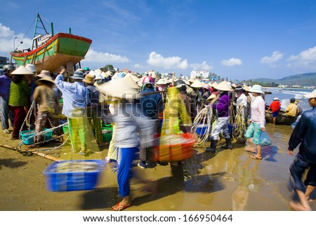 CIRCA APRIL 2011 - QUY NHON, VIETNAM - Women trade seafood at the beach, on 3 April 2011, in Quy Nhon, Vietnam