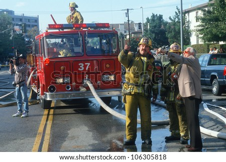 CIRCA 1998 - Firefighters with a witness at condominium in Brentwood, California