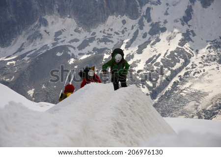 CIRCA JULY 2012 - MONT BLANC: climbers on tours in the Mont Blanc high mountain range near Auigulle du Midi, France.