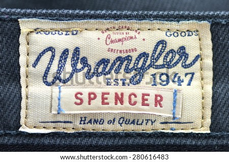 CIRCA JUNE 2014   KWIDZYN: Closeup of Wrangler label on blue jeans. Wrangler is American manufacturer of jeans. Its headquarters is in Greensboro, North Carolina, USA.