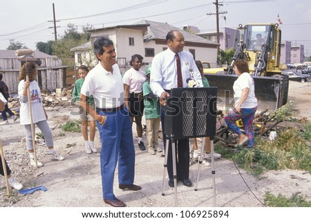 CIRCA 1990 - Mayor Tom Bradley overseeing urban cleanup efforts on Earth Day - stock photo