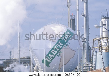 """CIRCA 1990 - Tank painted as a globe with the words """"Earth Day 1970-1990""""  at a Unocal oil refinery in Los Angeles, CA - stock photo"""