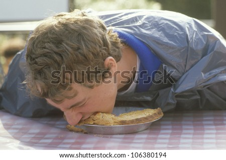 Pie eating stock photos illustrations and vector art