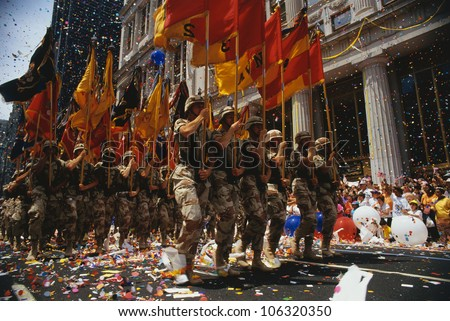 CIRCA 1991 - This is a Ticker Tape Parade showing the Desert Storm Victory Parade. It took place in the Canyon of Heroes.  This shows army soldiers marching in line. - stock photo