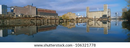 CIRCA 1998 - This shows an industrial building through a clearing of trees on the Rogue River. - stock photo