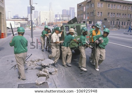CIRCA 1990 - Urban cleanup crew in Los Angeles on Earth Day - stock photo