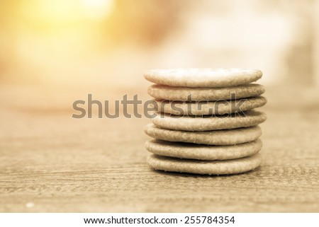 Circle biscuit stack on table. Vintage filter - stock photo